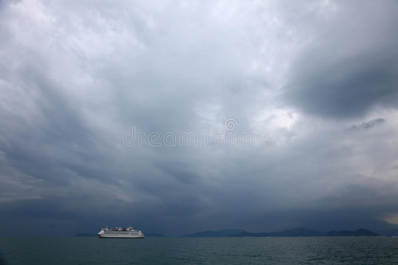 Stormy Sky. A Ship moored in calm ocean under Stormy Sky stock photo