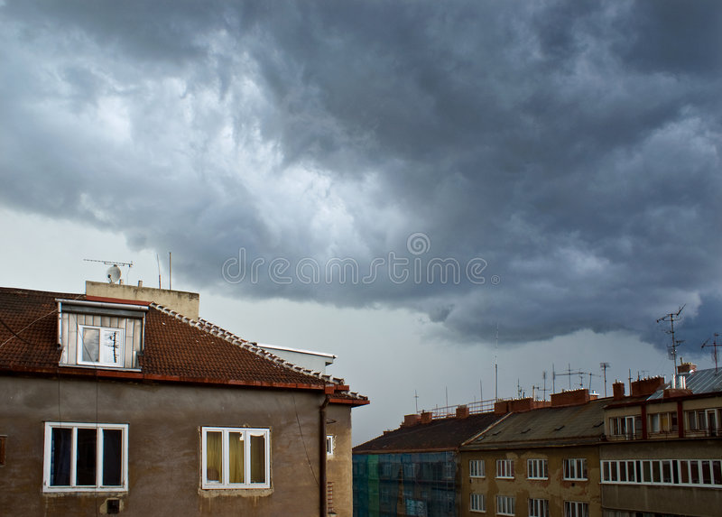 Stormy sky above town royalty free stock photo
