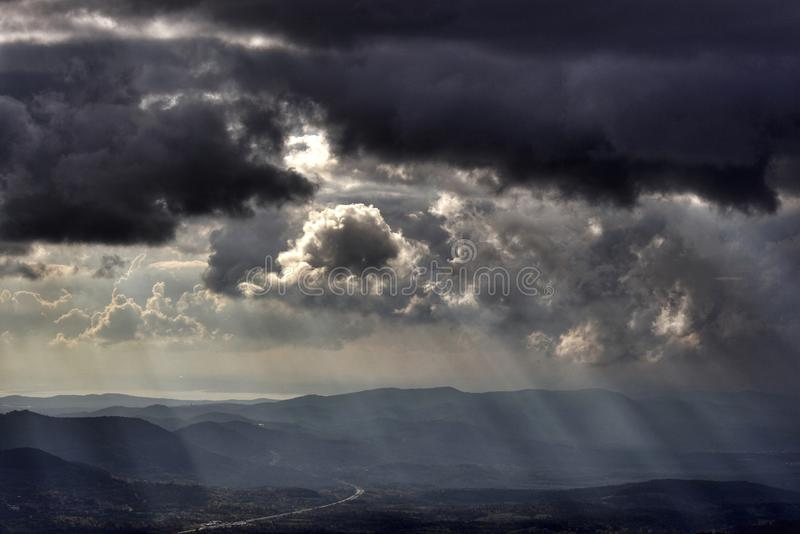 Stormy sky and clouds. Beams of light in stormy sky stock photos