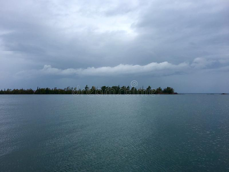 Stormy sky over Copper Harbor, Upper Peninsula, Michigan. View of Lake Superior and Hunter`s Point Park from Copper Harbor, Keweenaw County, in Michigan`s Upper royalty free stock photo