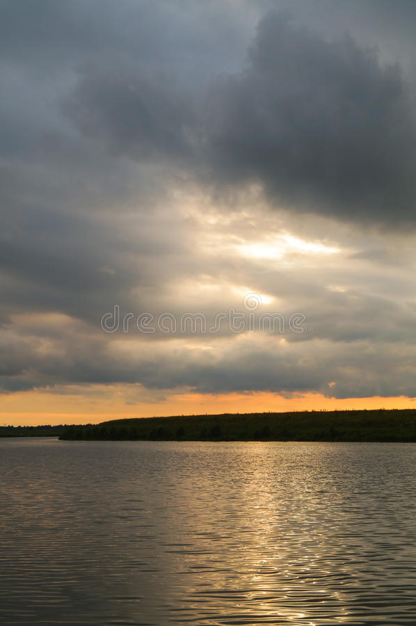 Stormy sky over the night river. stock photo