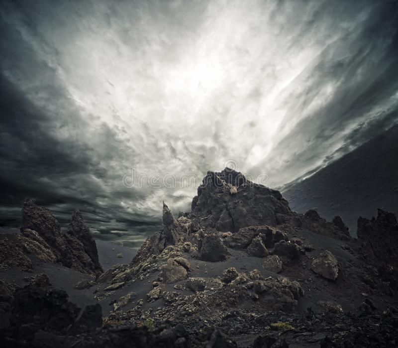 Stormy sky over rocks royalty free stock photography