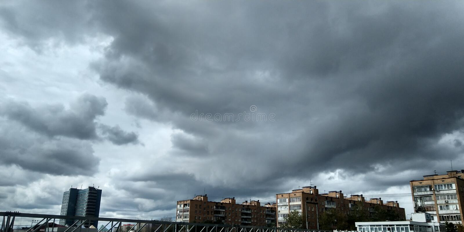 Stormy sky. Sky before the rain. Weather background. Gray and blue colors.  royalty free stock photos