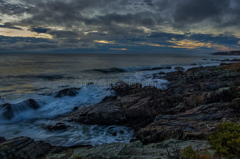 Stormy sunrise on the Maine coast stock images