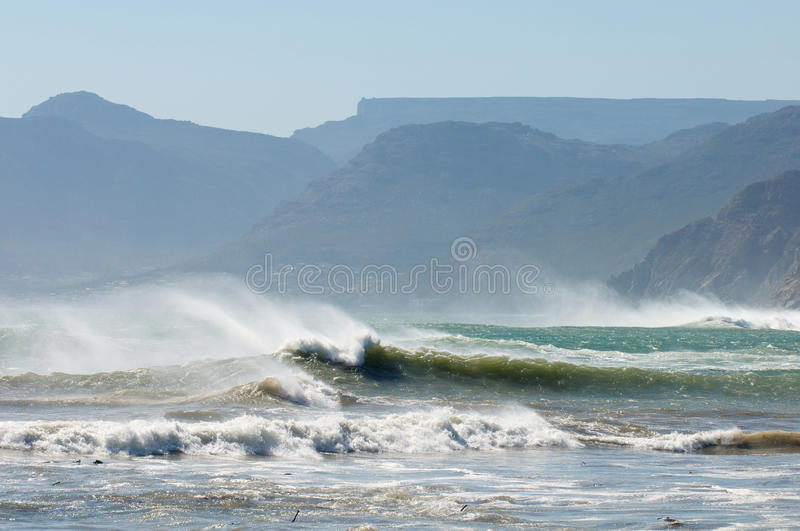 Stormy Swells Cape Town. Off shore winds with big swells at Kommetjie near Cape Town royalty free stock image