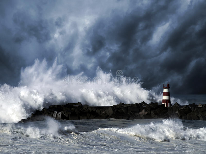 Stormy waves against beacon royalty free stock photo