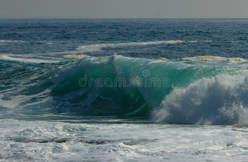 Stormy waves breaking on the shore on a sunny day at Cape Tobizin, Russian Island, Vladivostok royalty free stock photography