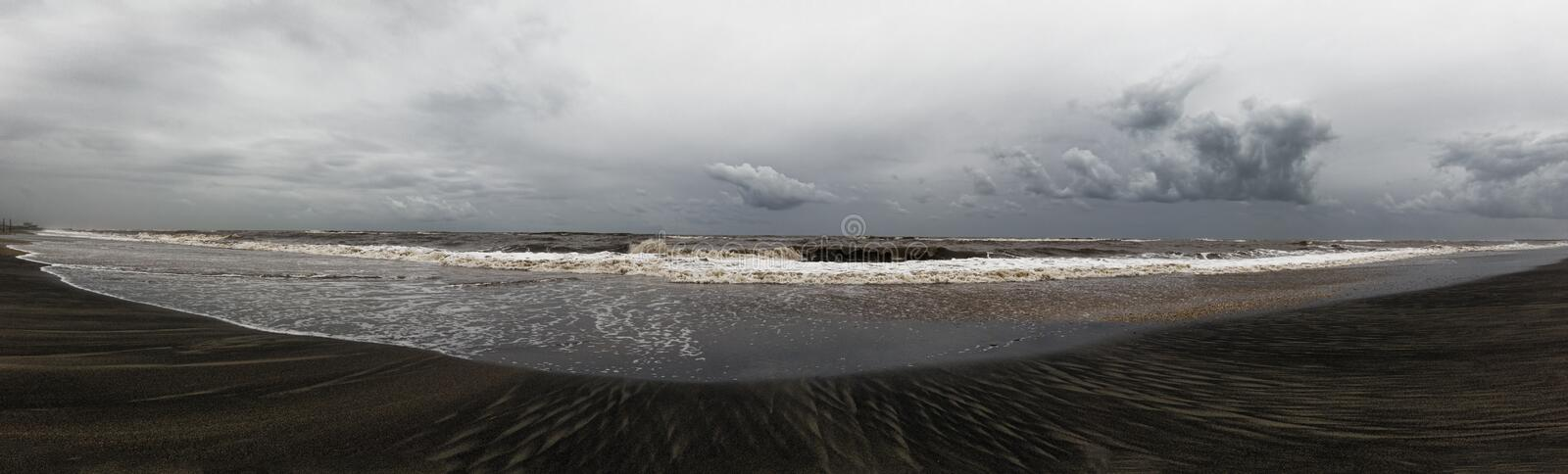 Stormy weather on the beach, the waves crash on the shore leaving their mark, overcast sky with beautiful cumulus clouds rain, stock images