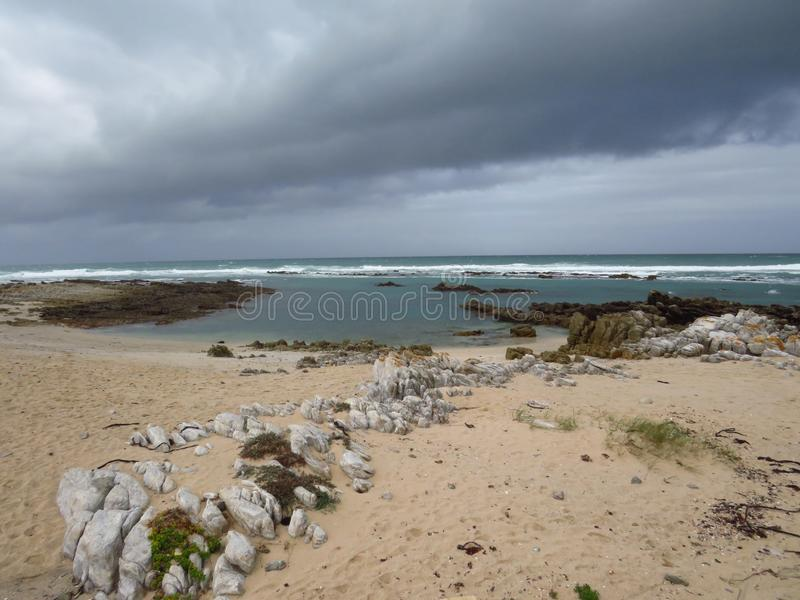 Stormy weather over Agulhas beach royalty free stock image