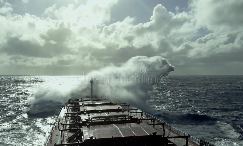 Stormy weather in the Pacific Ocean, ship and wave movement royalty free stock photography