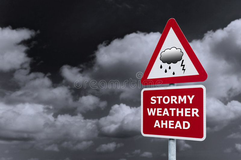 Stormy weather signpost. Concept image of a signpost with Stormy Weather Ahead against a dark cloudy sky stock photo