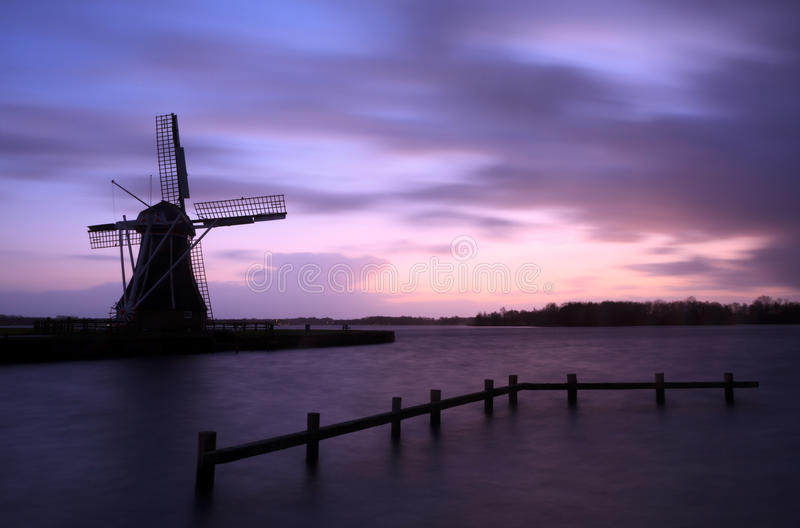 Stormy windmill royalty free stock photography