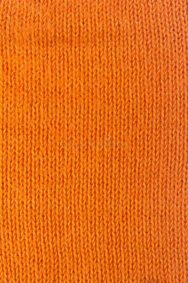 Stort handarbete för tröja- eller halsduktygtextur Stucken ärmlös tröjabakgrund med en lättnadsmodell Ullhandmaskin arkivfoton