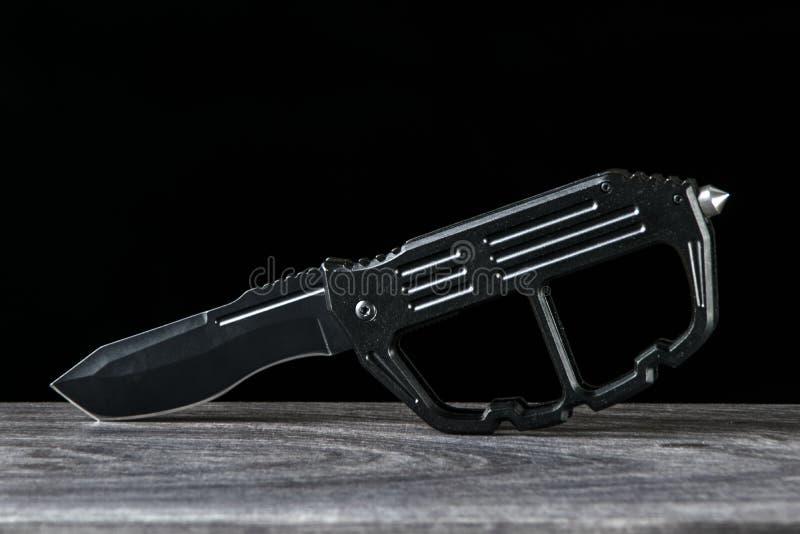 Stort hopfällbart knivkors för kök royaltyfri foto