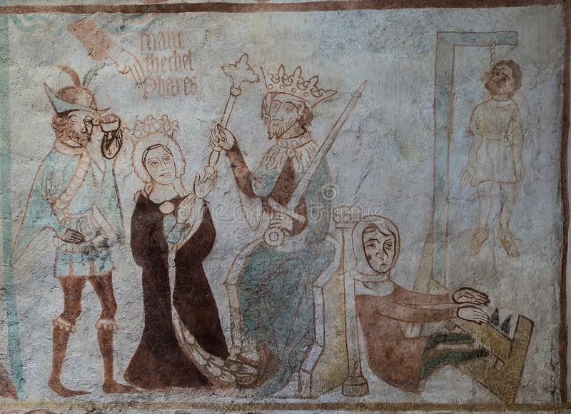 A story from The Book of Esther in the Old testament. A 500 years old gotic mural in Tirsted church, Denmark, April 17, 2019 stock image