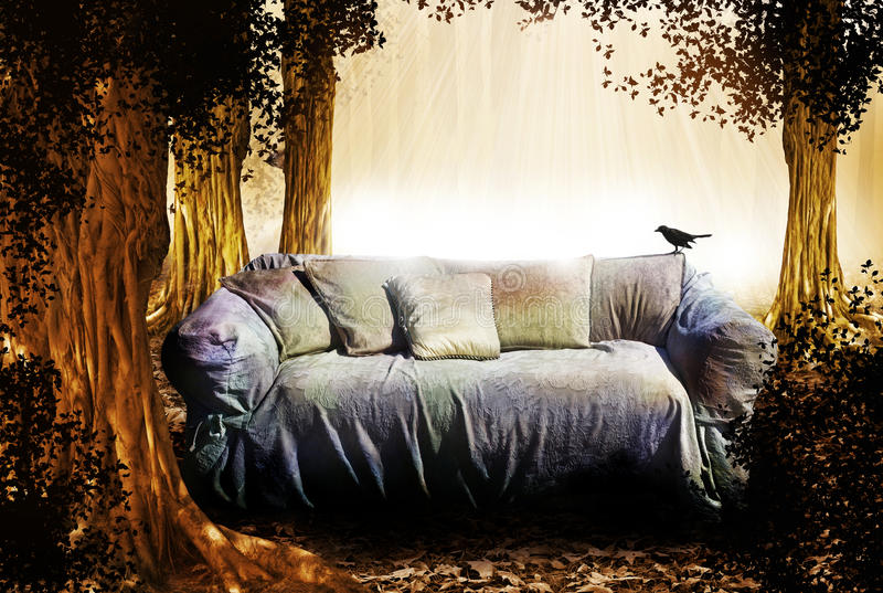 Story time. An old couch in a mystical fantasy forest setting with a bird on the couch and squirrel in the tree behind the couch. Concept for a fairy tale or royalty free stock photo