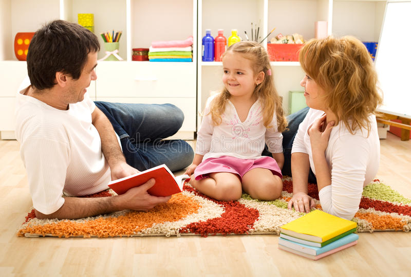 Story time - happy family with a child stock photography
