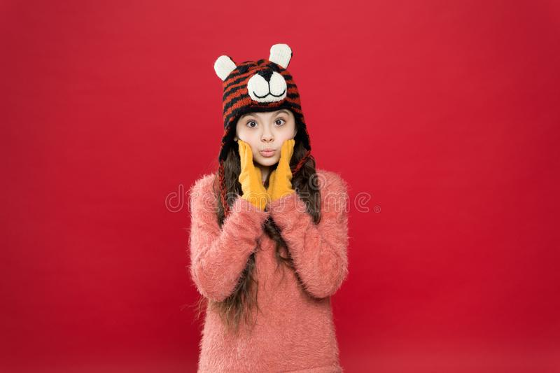 The story of winter. fashion for kids. funny knitwear accessory. small happy girl in knitted hat. cheerful child in. Gloves wear warm clothes. have fun on stock photos