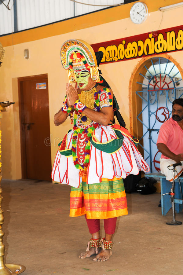 Storyteller with his band performing dance and music. Kollam, India - 18 January 2015: a storyteller with his band performing dance and music at the festival of stock photo