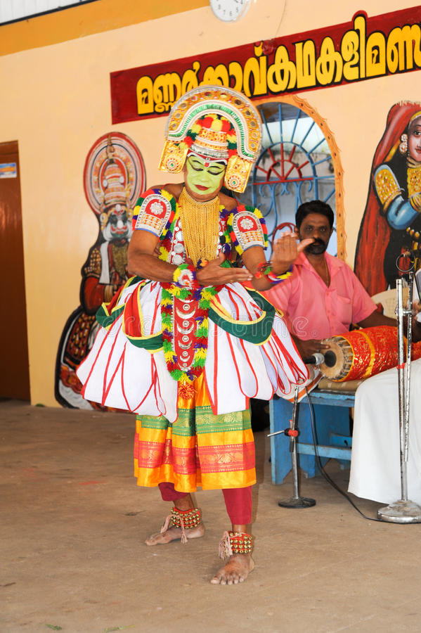 Storyteller with his band performing dance and music. Kollam, India - 18 January 2015: a storyteller with his band performing dance and music at the festival of stock image