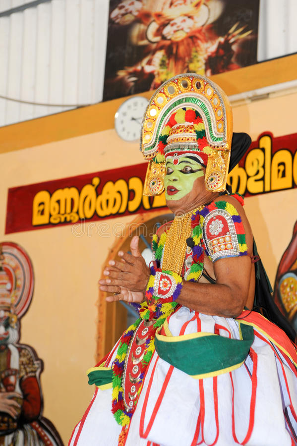 Storyteller with his band performing dance and music. Kollam, India - 18 January 2015: a storyteller with his band performing dance and music at the festival of stock images
