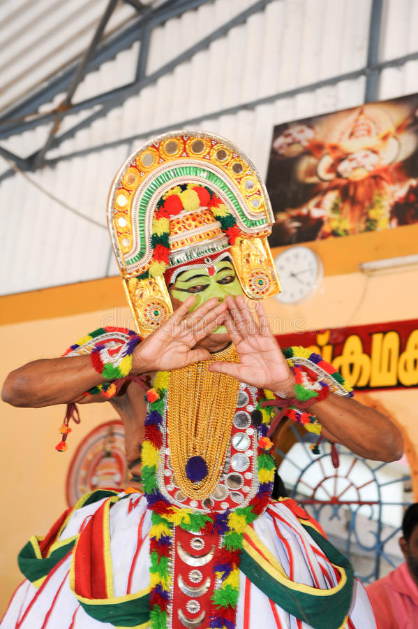 Storyteller with his band performing dance and music. Kollam, India - 18 January 2015: a storyteller with his band performing dance and music at the festival of royalty free stock image