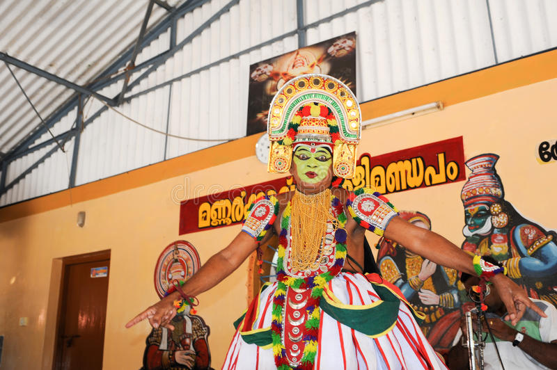 Storyteller with his band performing dance and music. Kollam, India - 18 January 2015: a storyteller with his band performing dance and music at the festival of royalty free stock photo