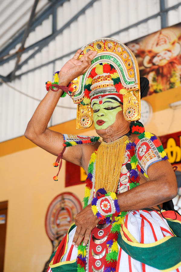 Storyteller with his band performing dance and music. Kollam, India - 18 January 2015: a storyteller with his band performing dance and music at the festival of royalty free stock photography