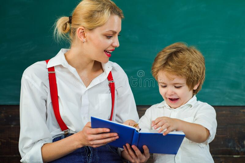 Storyteller. An interesting story in a book for children. Tutor asks the tutee to find the definition in the textbook. Storyteller. An interesting story in a stock photography