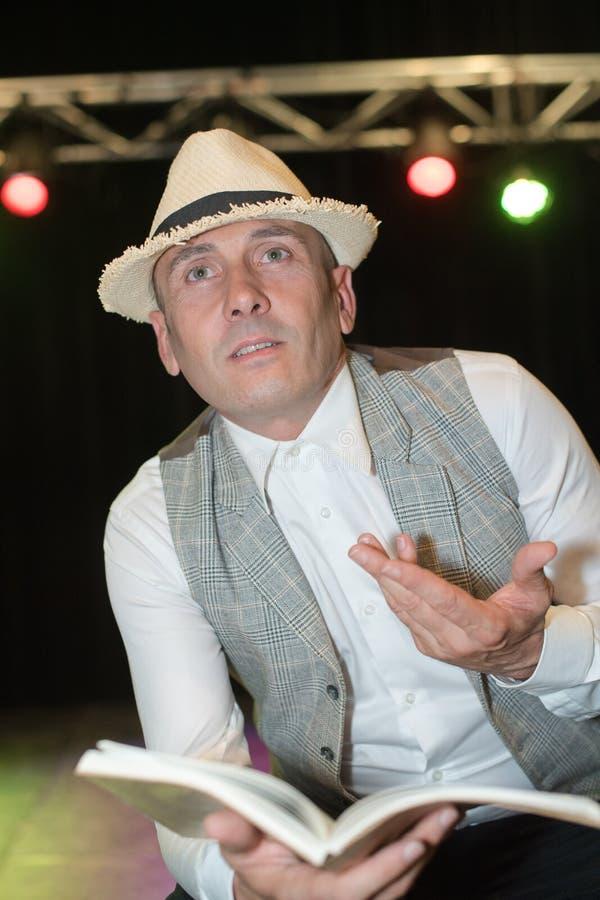 Storyteller performing on stage. Storyteller stock photo