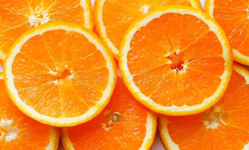 Stos jaskrawe pokrojone pomarańcze obrazy stock