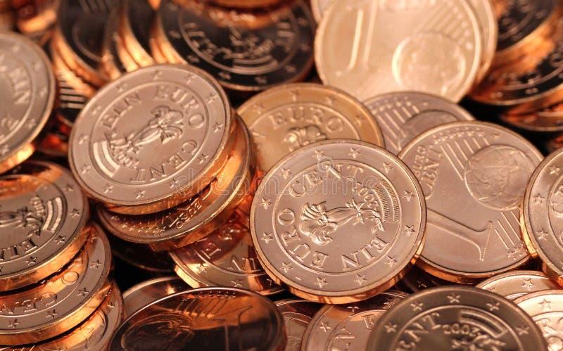 Stos jeden Euro centu monety zamyka w górę zdjęcie royalty free
