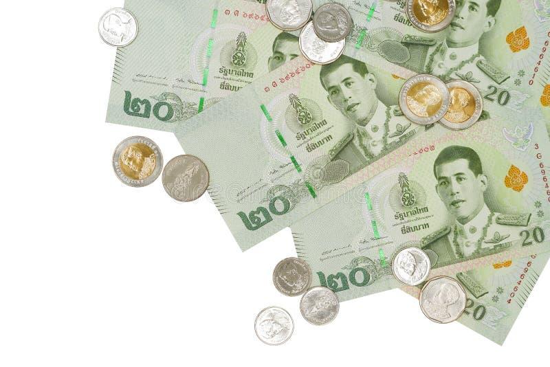 Stos nowi 20 Tajlandzkiego bahtu banknotów i monety obrazy royalty free