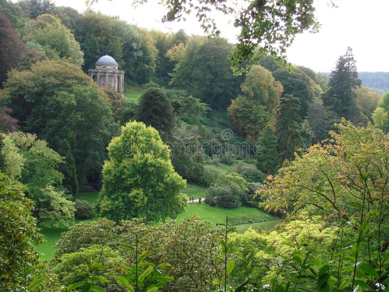 Stourhead Garden. Stourhead  is situated at the source of the river Stour, in  Wiltshire County, Britain. The estate includes Palladian Mansion, gardens, grotto royalty free stock images