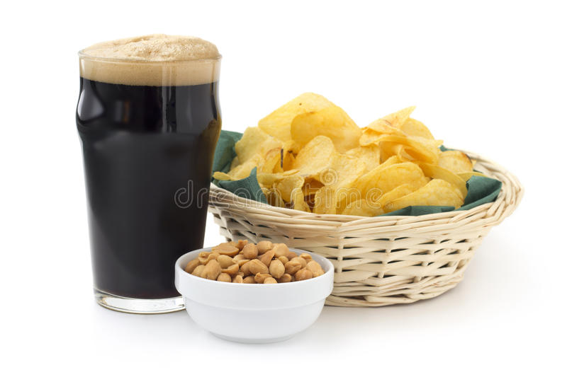 Stout with peanuts and chips royalty free stock images