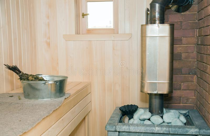 Stove with stones in the Russian bath. In the steam room stock photo