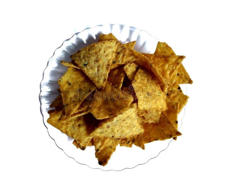 Strålning av nachos med ost med vit bakgrund typiska mexikanska livsmedel royaltyfria bilder