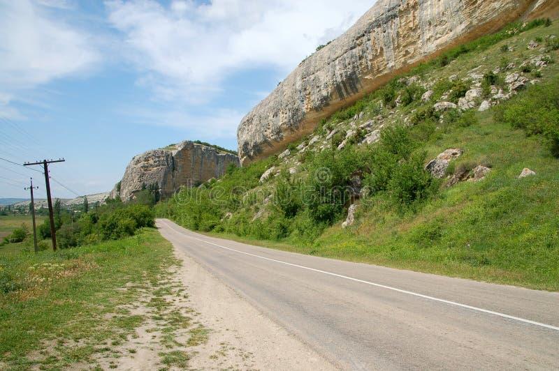 Straße und Felsen stockfotos