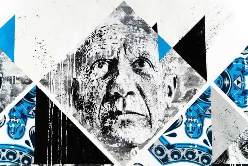 Straßen-Kunst von alter Mann ` s Gesicht lizenzfreies stockfoto