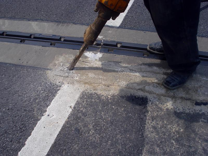 Straßenarbeitskraft auf Straße lizenzfreie stockfotografie