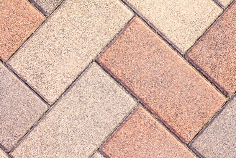 Straßenbodenfliesen als Hintergrund lizenzfreie stockfotos