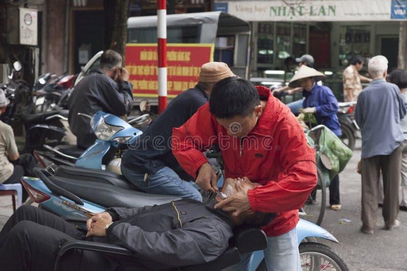 Straatkapper in Hanoi royalty-vrije stock foto