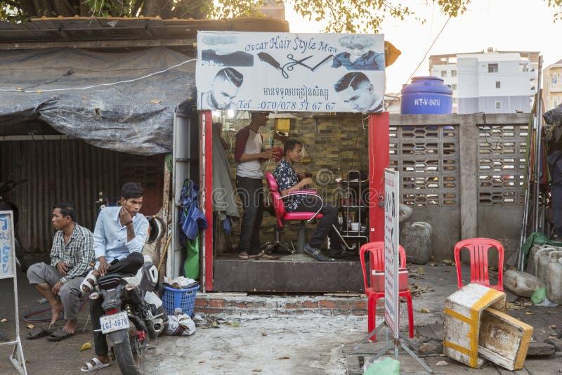 Straatkapper in Phnom Penh stock foto's