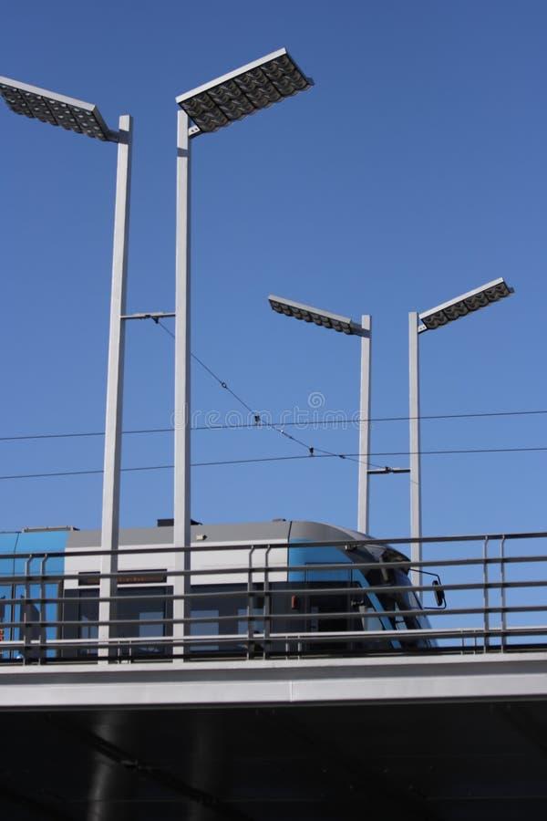 Straatlantaarns en tram stock foto's