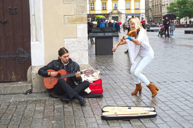 Straatmusici in Krakau stock afbeeldingen