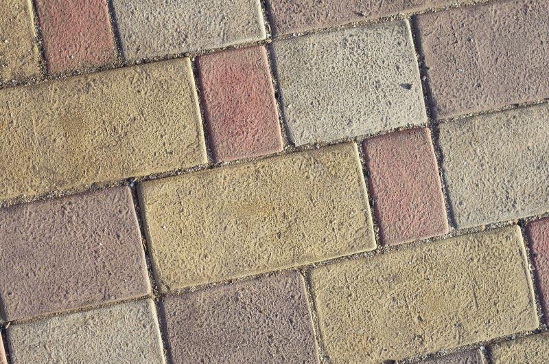 Straatsteen kleurrijk patroon van bakstenen Achtergrond stock foto