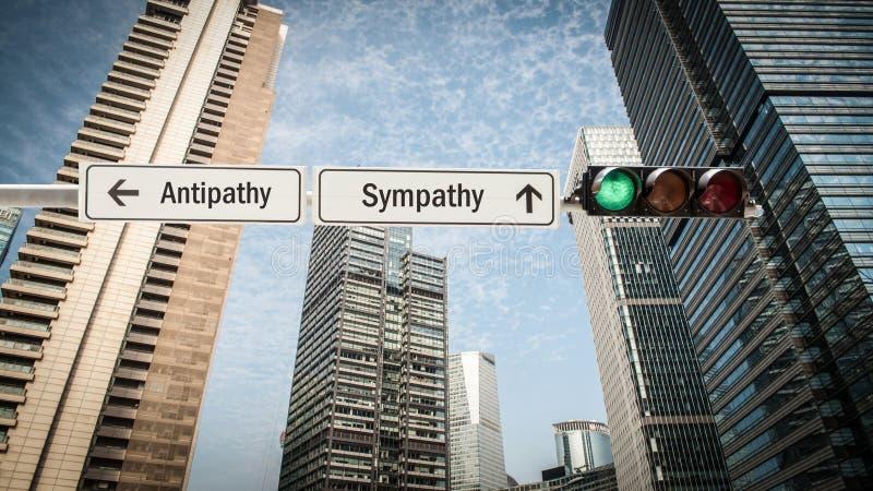 Straatteken aan Sympathie tegenover Antipathie stock afbeeldingen
