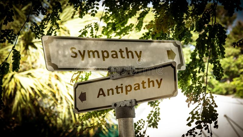Straatteken aan Sympathie tegenover Antipathie stock foto's