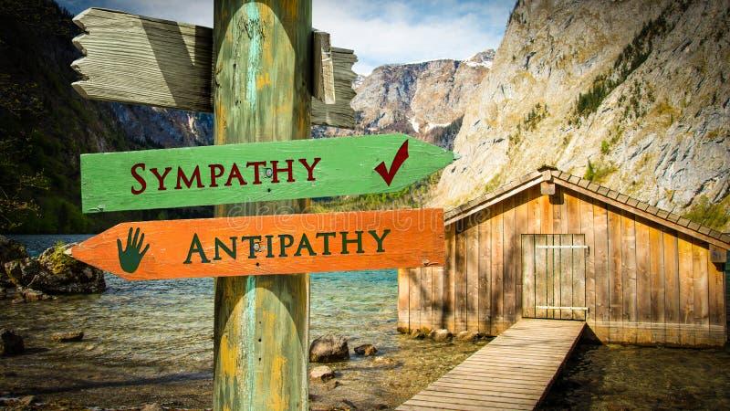 Straatteken aan Sympathie tegenover Antipathie royalty-vrije stock foto