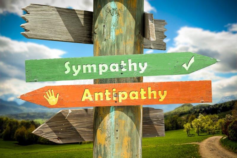 Straatteken aan Sympathie tegenover Antipathie stock foto